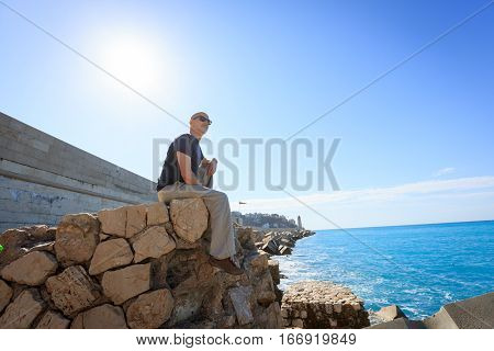 Tourist to Nice enjoying the sight near the habor