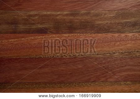 Texture of glued polished red wooden panel