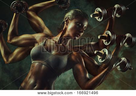 Strong fantasy woman bodybuilder with many hands and dumbbells. Super power and sports working and motivation concept.