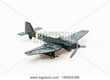 Dusty toy German WWII plane isolated on a white background