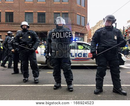 WASHINGTON, Jan. 20, 2017 -- Police in riot gear surround detained #DisruptJ20 protesters during the presidential inauguration of Donald Trump, resulting in a mass arrest and