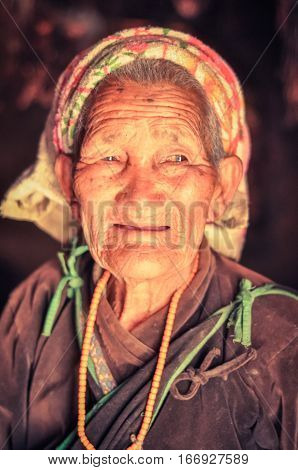 Old Woman In Brown Shirt In Nepal