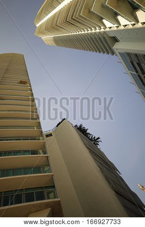 Stock photo of highrise towers above on a blue sky