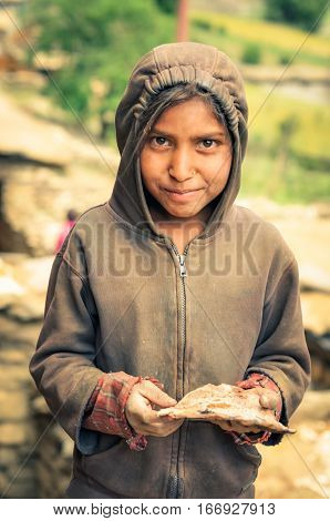 Girl In Brown Hood In Nepal