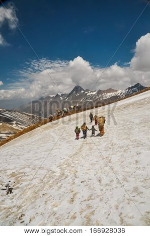 Mother And Children In Snow In Nepal