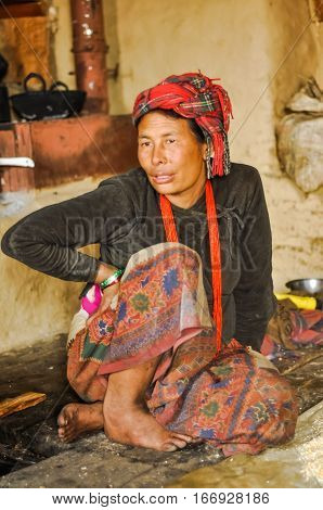 Talking Woman With Headcloth In Nepal