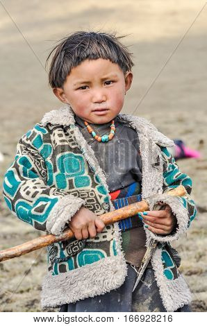 Girl With Pick-axe In Nepal