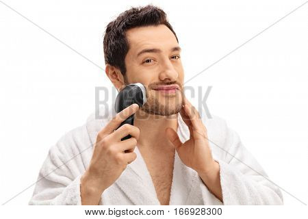 Handsome guy trimming his beard with an electric razor isolated on white background