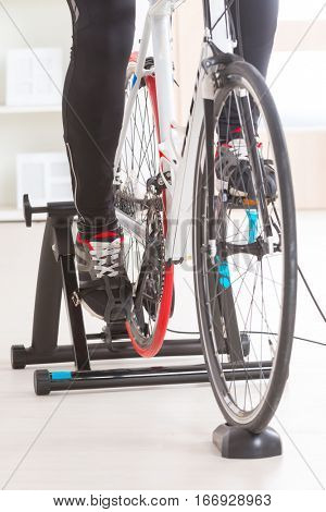 Man using cycle trainer at home