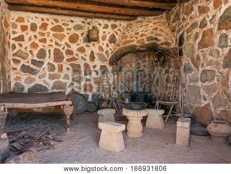 Interior with hearth of ancient room in cave