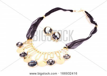 Stylish necklace and earrings with stones isolated on white background.
