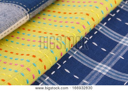 Colorful kitchen towels stack  close up picture.