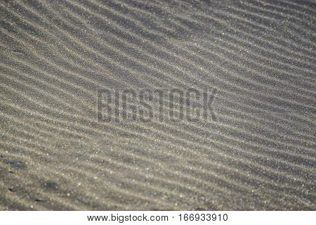 Closeup sand texture. Brown sand. Background from fine sand. Sand background