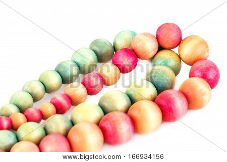 Necklaces with wooden beads isolated on white background.