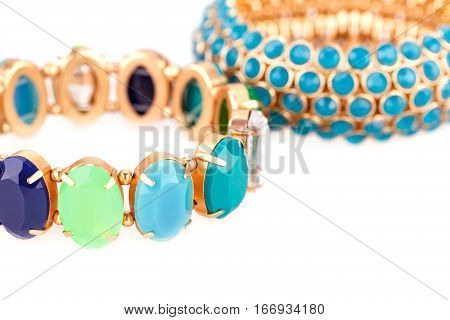 Stylish bracelets with colorful stones isolated on white background.