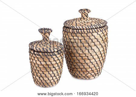 Two wicker boxes isolated on white background.