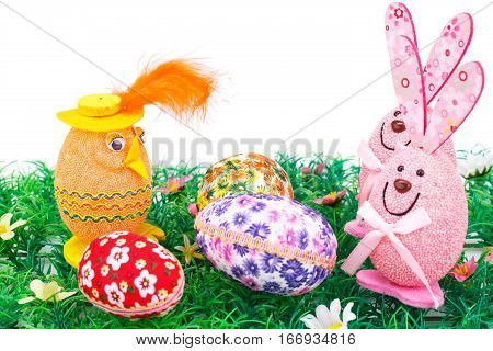 Easter eggs and bunnies decoration on artificial grass.