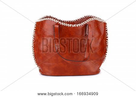 Brown leather handbag isolated on white background.