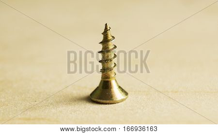one screw screw on a wooden background