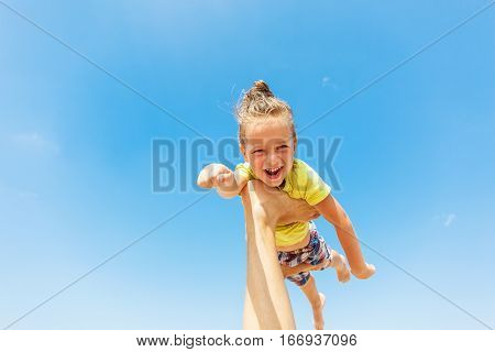 Flying boy like superman on the blue sky background