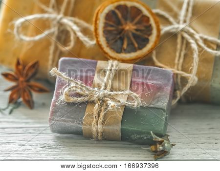 beautiful fragrant handmade soap lies on a circular base on a wooden background