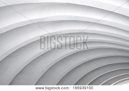Architectural background. Modern white concrete arched ceiling in perspective. Same semicircular shape.