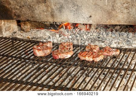 Closeup of Sirloin steaks on grill and fire