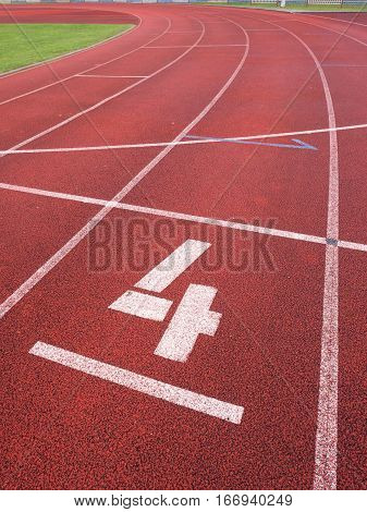 Number Four. White Track Number On Run Rubber Racetrack,