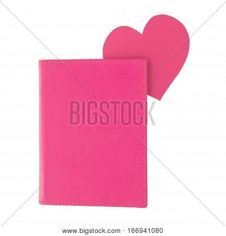Pink paper heart bookmark inside a pink book isolated on white background