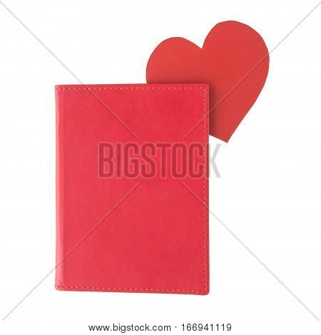 Red paper heart bookmark inside a red book isolated on white background