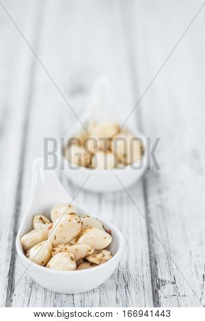 Garlic (preserved) On Wooden Background (selective Focus)