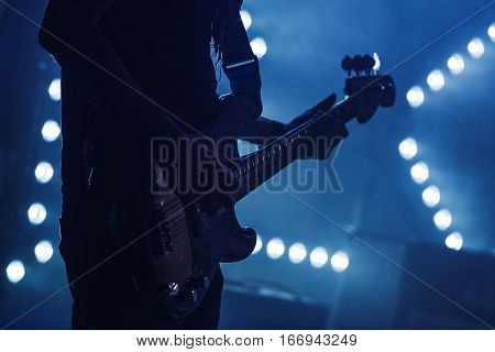 Electric Bass Guitar Player On Stage
