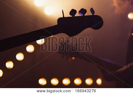 Electric Bass And Solo Guitar Silhouettes,