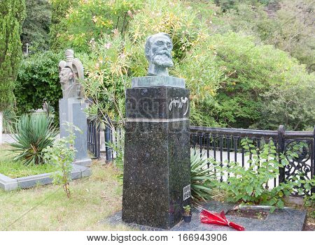 TBILISI, GEORGIA - AUGUST 08, 2013: The tomb of the Georgian poet Galaktion Tabidze (1892-1959)in the Mtatsminda Pantheon of Writers and Public Figures in the Tbilisi.