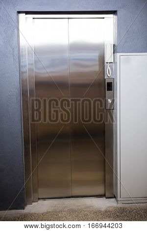 Modern elevator with closed door in office