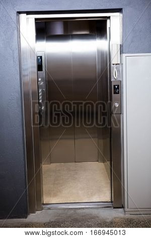 Modern elevator with open doors in office