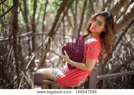beautiful young asian woman in the autumn park