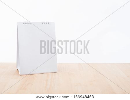 blank calendar planner and wood desk office on white background.
