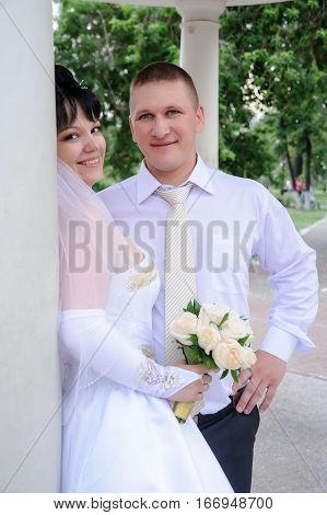 Cutie happy married couple bride on nature background