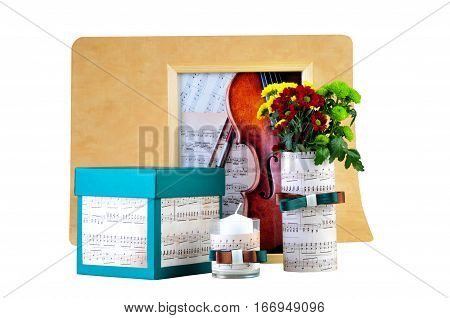 Ukraine Kiev - January 25 2017: Romantic composition made of candle flowers songbook and box with a present. The concept of romantic atmosphere- illustrative editorial.
