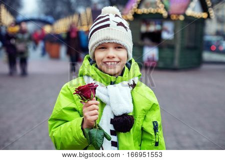 The little boy has a rose for congratulations. The concept of lifestyle love Valentine's Day.The little boy has a rose for congratulations. The concept of lifestyle love Valentine's Day.