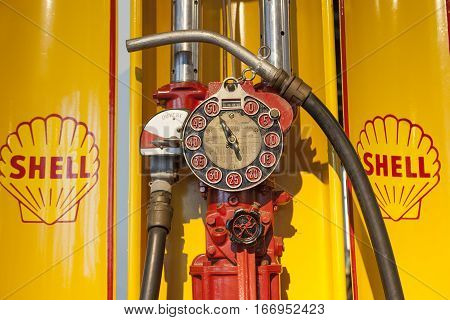Malaga Spain - December 4 2016: old Shell Oil Company manual gas pump displayed at Car Museum in Malaga