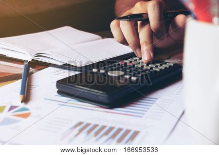 Close Up Woman Hand Doing Finance And Calculate About Cost On Desk At Home Office.