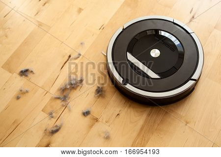 robotic vacuum cleaner on laminate wood floor smart cleaning technology dust
