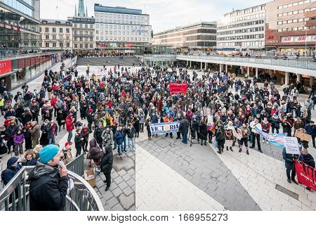 Anti-Trump day and woman's march. Stockholm, Sweden - January 21, 2017: Protest meeting at public square before Anti-Trump march January 21, 2017. People gathered on square listening to speaker.