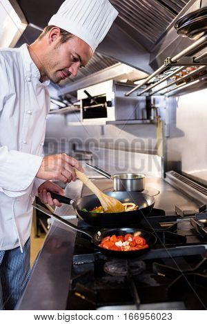 Chef preparing food in the kitchen of a restaurant