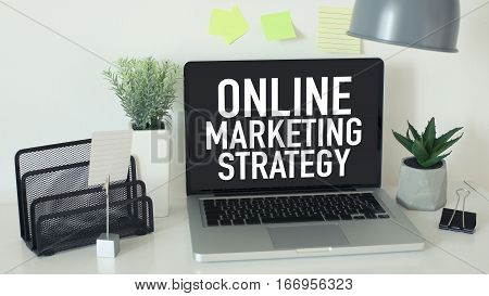Online internet marketing business concept with laptop on office desk