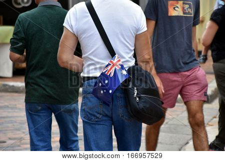 Sydney, Australia - January 26, 2016. Australia flag in the bag. People celebrating Australia Day in Sydney.