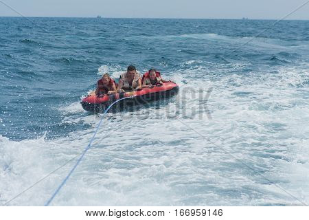 Young People On Water Attractions During Summer Vacations.