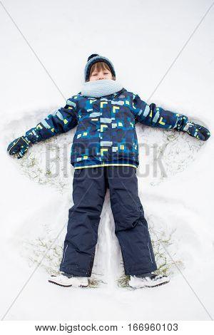 Little Sweet Child, Boy, Lying On North Pole Snow, Making Snow Angel